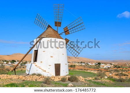 Old traditional built in canary style windmill in Valle de Santa Ines village, Fuerteventura, Canary Islands, Spain - stock photo