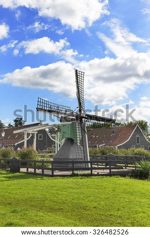 Old traditional Dutch windmill in the summer. - stock photo