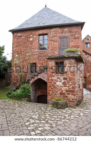 Old traditional French house in Collonges La Rouge, France - stock photo