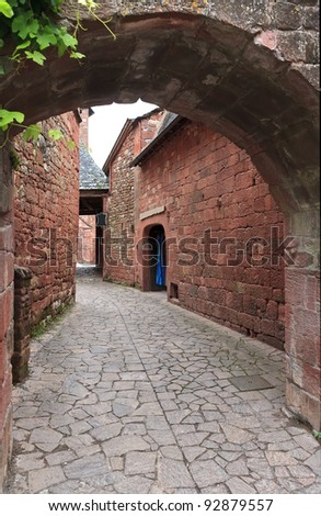 Old traditional houses in Collonges La Rouge - stock photo