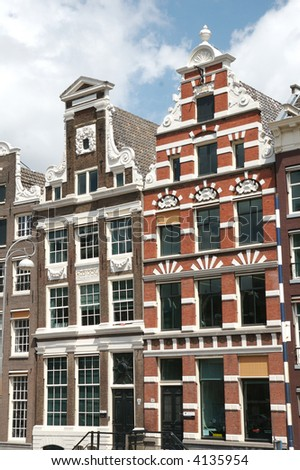 Old traditional houses in the Center of Amsterdam (The Netherlands). - stock photo