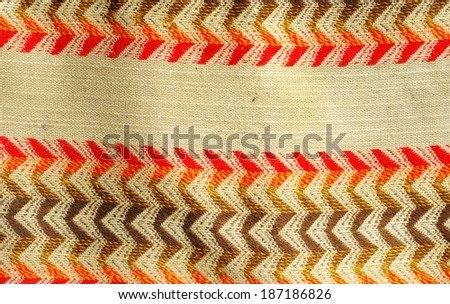 Old traditional Moroccan carpet with ancient motifs - stock photo