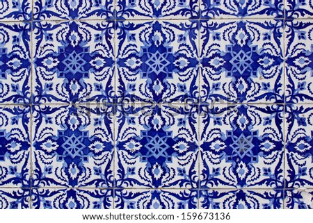 old traditional portuguese azulejo tiles on a wall of a house in Porto