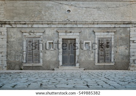 Old traditional seaside house facade in Sampieri, sicilian village in Italy