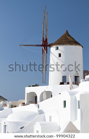 Old traditional Windmill at Oia of Santorini island in Cyclades, Greece - stock photo