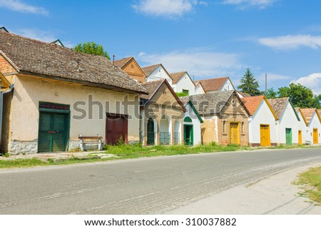 Old traditional wine cellars in Hungary, Baranya county, Villany. - stock photo
