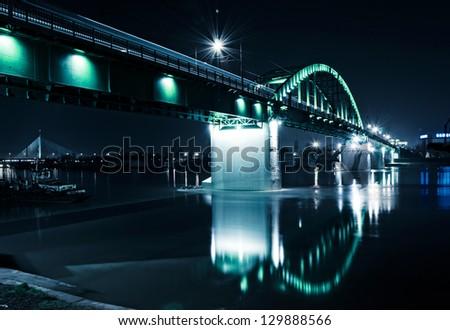 Old train bridge in Belgrade at night. Shoot at the long exposure. - stock photo