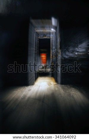 Old train carriage interior with light intruding - stock photo