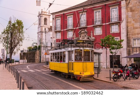 Old tram on a Lisbon street - Portugal - stock photo