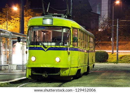 Old tram on a street, at nihgt - stock photo