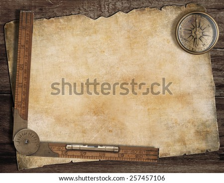 Old treasure map background with compass and wood ruler. Exploration concept. - stock photo