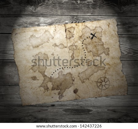 old treasure map, on wooden grunge background - stock photo