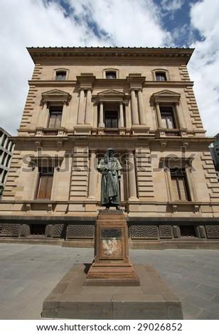 Old Treasury building and a statue in Melbourne, Victoria, Australia - stock photo