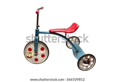 old tricycle communist era retro toy over white background
