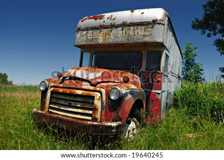 Old truck abandoned  in the field - stock photo
