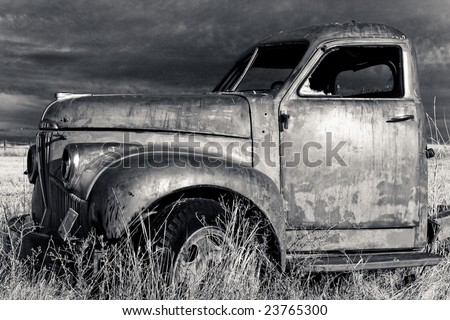 Old truck in the moonlight - stock photo