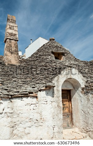 Old Trullo house under a blue sky in Alberobello, Puglia, Italy