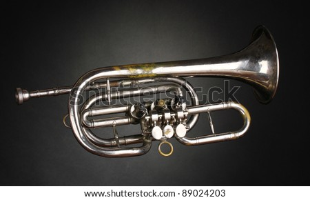 old trumpet on gray background