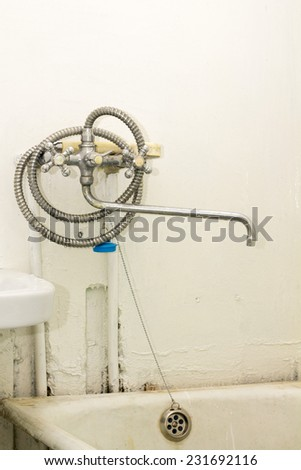 old tub and shower - stock photo