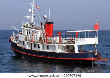 Old tug converted in pleasure private yacht - stock photo