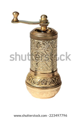 Old Turkish metal grinder on the white background, isolated. - stock photo