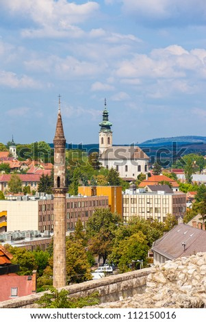 Old Turkish Minaret against the Hungarian town of Eger, Hungary. - stock photo