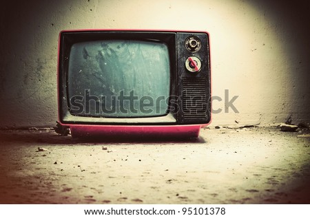 Old TV in room. Retro style colors. - stock photo