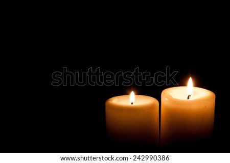 Old Two burning candles in the dark , Vintage look. - stock photo
