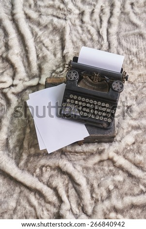 old typewriter and paper - stock photo