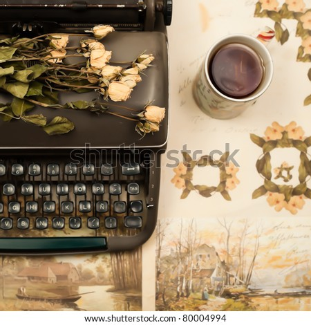Old typewriter and roses - stock photo