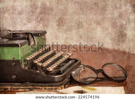 Old typewriter, glasses and letters on the table - stock photo