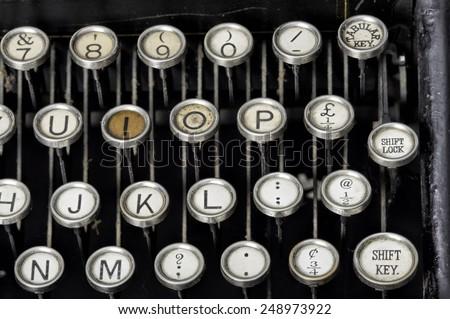 Old typewriter keys - stock photo