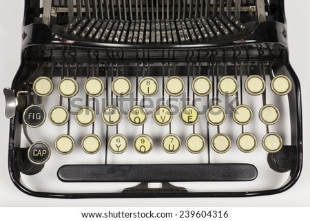 Old typewriter keys rearranged to say I LOVE YOU