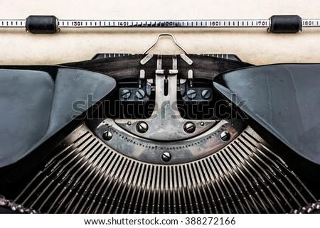Old typewriter on table. Closeup photo of a vintage typewriter. - stock photo