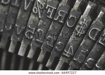 Old typewriter type focus on money symbol - stock photo