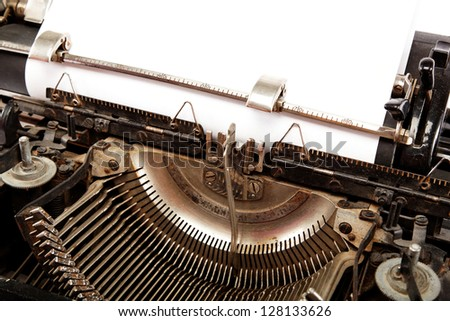 Old typewriter with a sheet of paper. - stock photo