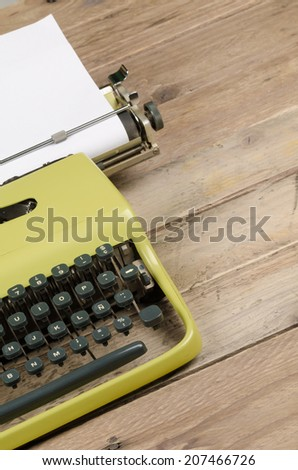 Old typewriter with a sheet of paper ready to be used - stock photo