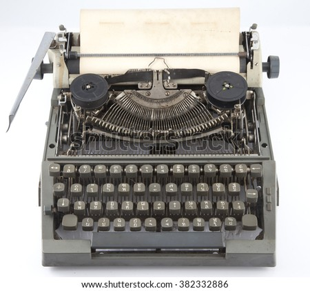 Old typewriter with blank sheet on white
