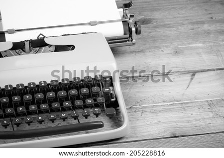 Old typewriter with paper on, ready for jounalist action, a concept