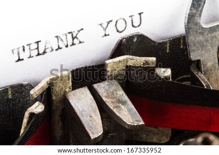 Old typewriter with text thank you - stock photo