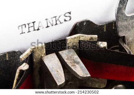 Old typewriter with text thanks - stock photo