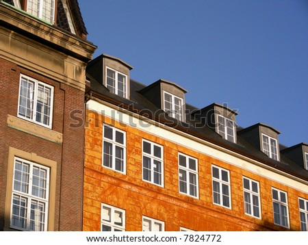 Old typical facade of a colorful building in the old center of Copenhagen on a sunny day