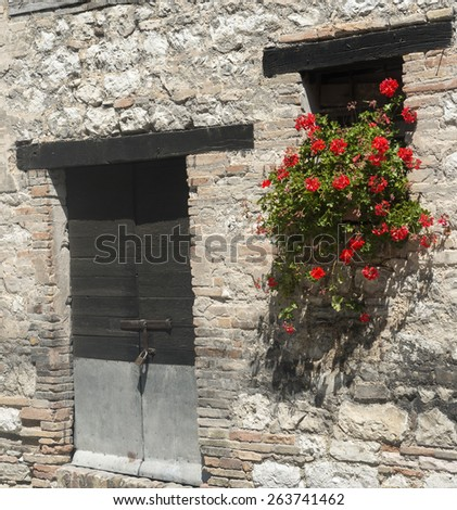 Old typical house in the village of Valcimarra, near Tolentino (Macerata, Marches, Italy), with flowers - stock photo