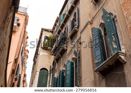 Old typical picturesque houses of Venice. Italy - stock photo