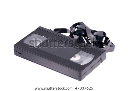 Old unusable vhs video cassette isolated on white background - stock photo
