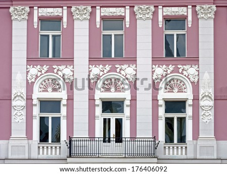 Old urban building stone facade with tall windows in Timisoara, Romania - stock photo