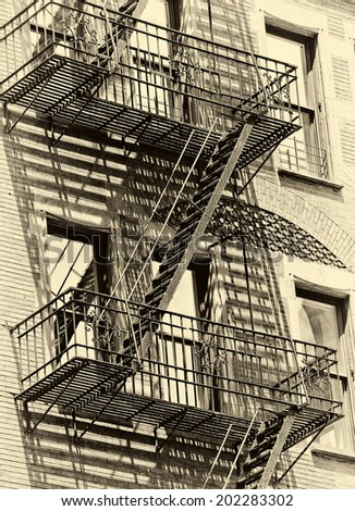 Old urban New York building with fire escape in new york , monotone  - stock photo