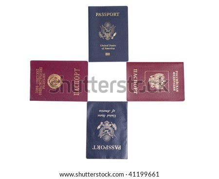 Old US, new US, USSR and Russian passports on white isolated background - stock photo