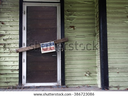 Old vacant house with Foreclosed notice on door