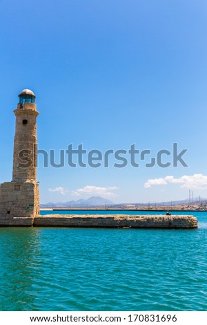 Old venetian lighthouse at harbor. Rethymno, Crete, Greece